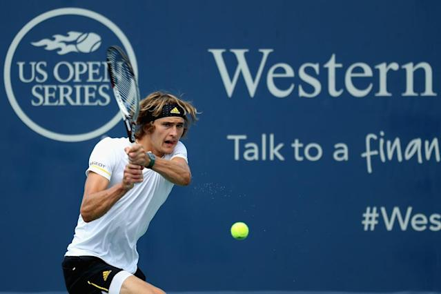 MASON, OH - AUGUST 16: Alexander Zverev of Germany returns a shot to Frances Tiafoe during Day 5 of the Western & Southern Open at the Linder Family Tennis Center on August 16, 2017 in Mason, Ohio. Rob Carr/Getty Images/AFPMASON, OH - AUGUST 16: Alexander Zverev of Germany returns a shot to Frances Tiafoe during Day 5 of the Western & Southern Open at the Linder Family Tennis Center on August 16, 2017 in Mason, Ohio. Rob Carr/Getty Images/AFP (AFP Photo/Rob Carr)