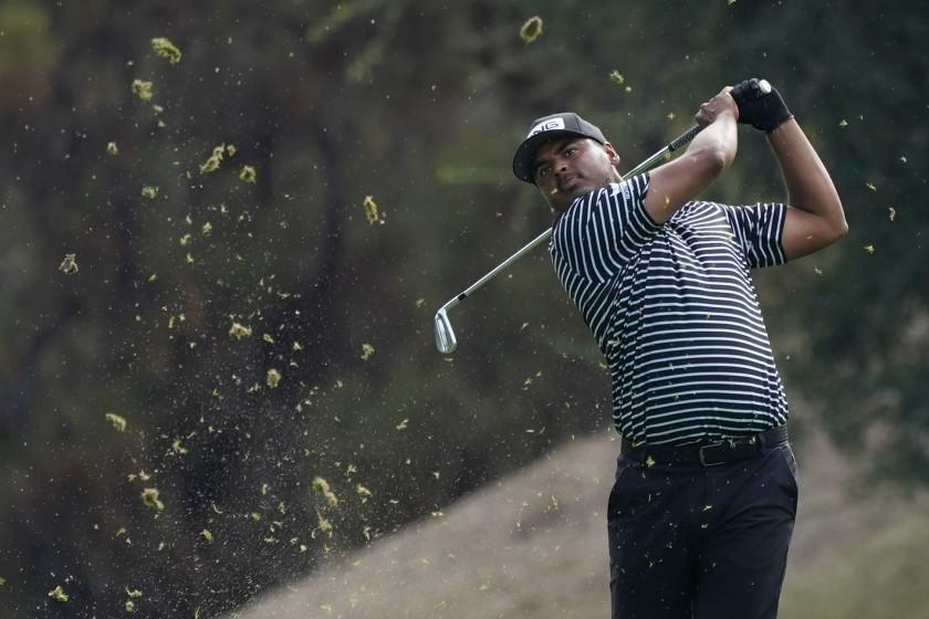 Sebastian Munoz hits from the 18th fairway during the first round of the Zozo Championship golf tournament Thursday, Oct. 22, 2020, in Thousand Oaks, Calif. (AP Photo/Marcio Jose Sanchez)