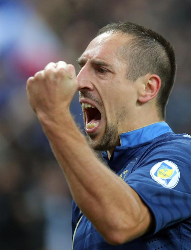 Franck Ribery of France celebrates his opening goal during his group I World Cup qualifying soccer match between France and Finland, at the Stade de France stadium in Saint Denis, outside Paris, Tuesday, Oct. 15, 2013. (AP Photo/Michel Euler)