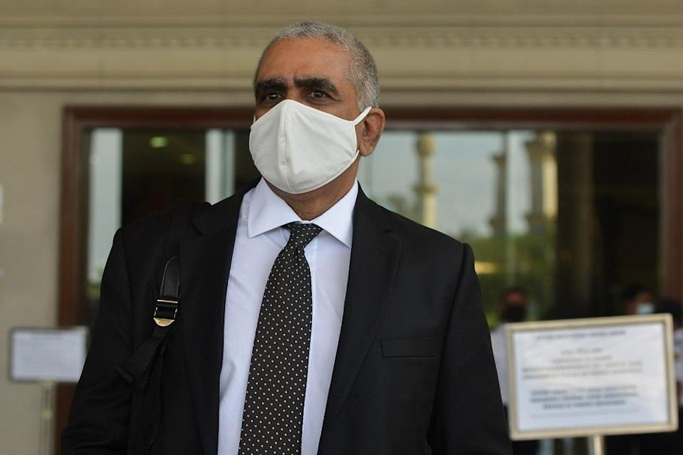 Lawyer M. Puravalen, who is representing the accused in a molest case, arrives at the Kuala Lumpur High Court March 22, 2021. — Picture by Miera Zulyana