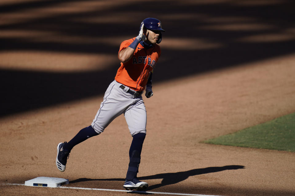 Houston Astros Carlos Correa rounds the bases after hitting a solo home run Tampa Bay Rays relief pitcher Peter Fairbanks during the sixth inning in Game 2 of a baseball American League Championship Series, Monday, Oct. 12, 2020, in San Diego. (AP Photo/Gregory Bull)