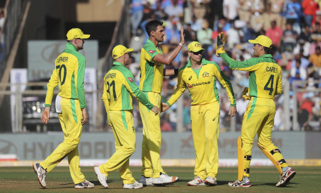 Australia's Mitchell Starc, center, celebrates the dismissal of India's Shreyas Iyer with his team players during the first one-day international cricket match between India and Australia in Mumbai, India, Tuesday, Jan. 14, 2020. (AP Photo/Rafiq Maqbool)