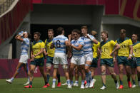 Argentina players, center, celebrate after defeating Australia in their men's rugby sevens match at the 2020 Summer Olympics, Monday, July 26, 2021 in Tokyo, Japan. (AP Photo/Shuji Kajiyama)