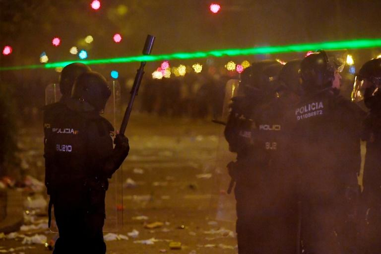 Laser pointers have been used to dazzle police in the Catalan protests -- a tactic copied from Hong Kong (AFP Photo/LLUIS GENE)