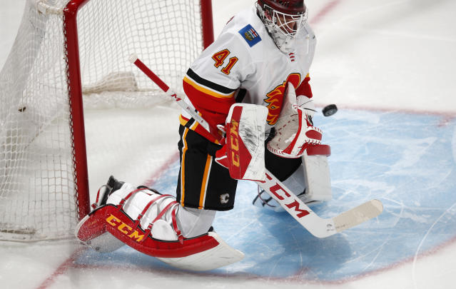 Calgary Flames goaltender Mike Smith stops a shot by the Colorado Avalanche during the first period of Game 4 of an NHL hockey playoff series Wednesday, April 17, 2019, in Denver. (AP Photo/David Zalubowski)