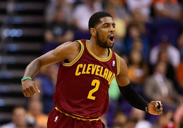 PHOENIX, AZ - MARCH 12: Kyrie Irving #2 of the Cleveland Cavaliers celebrates after scoring against the Phoenix Suns during the second half of the NBA game at US Airways Center on March 12, 2014 in Phoenix, Arizona. (Photo by Christian Petersen/Getty Images)