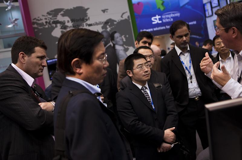 Visitors attend a briefing at the world's largest mobile phone trade show in Barcelona, Spain, Thursday March 1, 2012. (AP Photo/Emilio Morenatti)