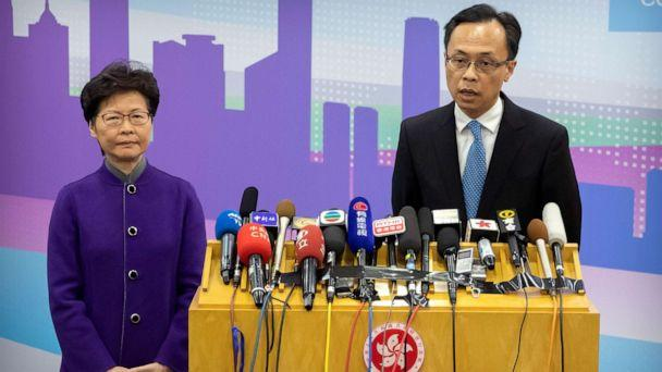 PHOTO: Patrick Nip, Hong Kong's Secretary for Constitutional and Mainland Affairs, speaks as Chief Executive Carrie Lam listens during a press conference in Beijing, Wednesday, Nov. 6, 2019. (AP Photo/Mark Schiefelbein) (Mark Schiefelbein/AP)