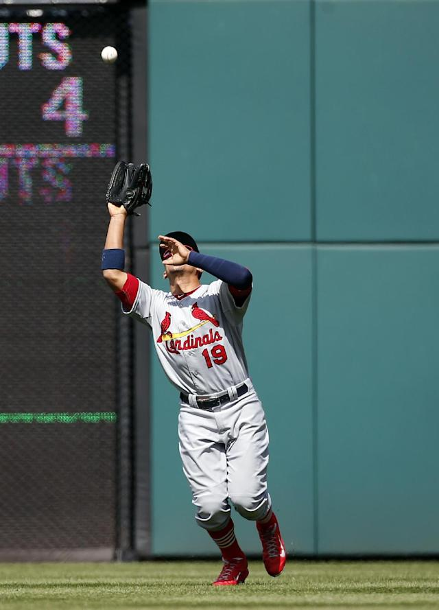 St. Louis Cardinals right fielder Jon Jay catches a fly ball hit by Washington Nationals' Adam LaRoche during the fifth inning of a baseball game at Nationals Park, Sunday, April 20, 2014, in Washington. (AP Photo/Alex Brandon)