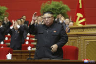 """In this photo provided by the North Korean government, North Korean leader Kim Jong Un acknowledges to the applauds after he made his closing remarks at a ruling party congress in Pyongyang, North Korea Tuesday, Jan. 12, 2021. Kim vowed all-out efforts to bolster his country's nuclear deterrent during the major ruling party meeting where he earlier laid out plans to work toward salvaging the broken economy. Independent journalists were not given access to cover the event depicted in this image distributed by the North Korean government. The content of this image is as provided and cannot be independently verified. Korean language watermark on image as provided by source reads: """"KCNA"""" which is the abbreviation for Korean Central News Agency. (Korean Central News Agency/Korea News Service via AP)"""