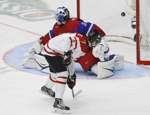 Canada's Josh Morrissey scores on Russia's goalie Andrei Vasilevski during the third period of their IIHF World Junior Championship ice hockey game in Malmo, Sweden, January 5, 2014. REUTERS/Alexander Demianchuk (SWEDEN - Tags: SPORT ICE HOCKEY)