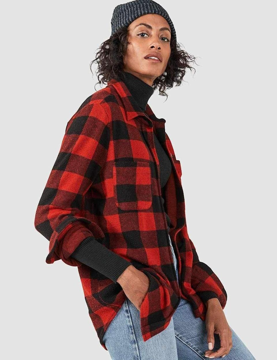 """<p><strong>Faherty</strong></p><p>fahertybrand.com</p><p><strong>$128.00</strong></p><p><a href=""""https://go.redirectingat.com?id=74968X1596630&url=https%3A%2F%2Ffahertybrand.com%2Fproducts%2Fknit-belmar-shirt-black-red-buffalo-check%3F_pos%3D32%26_sid%3D4b09f3948%26_ss%3Dr&sref=https%3A%2F%2Fwww.cosmopolitan.com%2Fstyle-beauty%2Ffashion%2Fg32678355%2Fflannel-outfits-how-to-wear%2F"""" rel=""""nofollow noopener"""" target=""""_blank"""" data-ylk=""""slk:Shop Now"""" class=""""link rapid-noclick-resp"""">Shop Now</a></p><p>The red-and-black buffalo check pattern is always a fall staple. Layer it with a turtleneck and add jeans and a beanie, and you'll look ready to jump into a pile of crunchy leaves. </p>"""