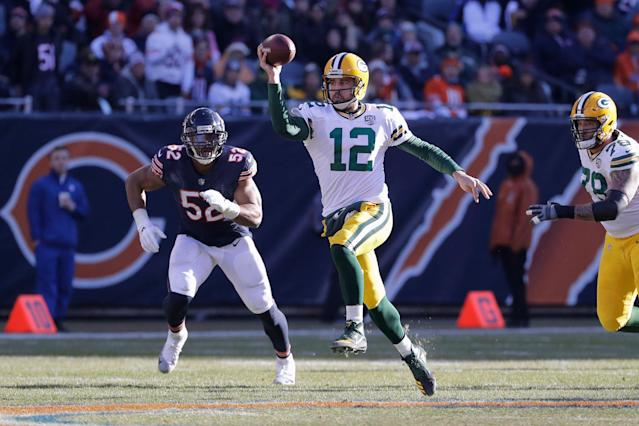 Aaron Rodgers (12) and the Packers will face Khalil Mack (52) and the Bears to start the season. (AP)