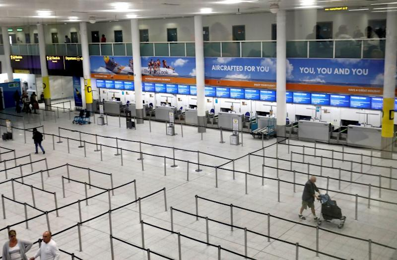 The closed Thomas Cook check-in desks are at the South Terminal of London Gatwick Airport on Sept. 23.