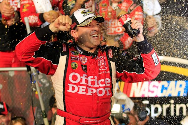 HOMESTEAD, FL - NOVEMBER 20: Tony Stewart, driver of the #14 Office Depot/Mobil 1 Chevrolet, celebrates in Victory Lane after winning the NASCAR Sprint Cup Series Ford 400 and the 2011 Series Championship at Homestead-Miami Speedway on November 20, 2011 in Homestead, Florida. Stewart wins his third NASCAR Championship. (Photo by Chris Trotman/Getty Images for NASCAR)