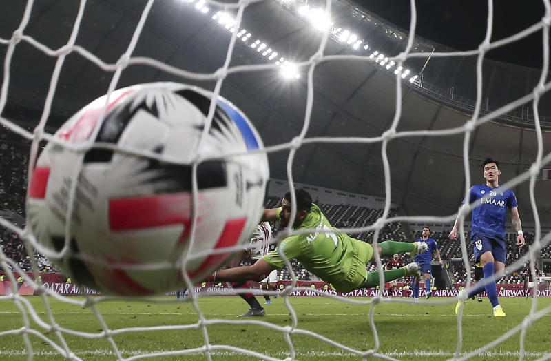 Flamengo's Bruno Henrique, left, scores his side's second goal during the Club World Cup semifinal soccer match between Flamengo and Al Hilal at the Khalifa International Stadium in Doha, Qatar, Tuesday, Dec. 17, 2019. (AP Photo/Hassan Ammar).