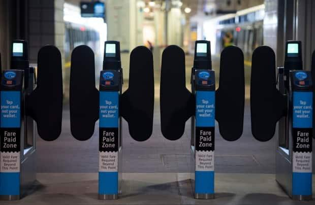 SkyTrain fare gates are pictured in downtown Vancouver on April 20, 2020. As of Sept. 1, 2021, children 12 and under can ride public transit in B.C. for free. (Jonathan Hayward/The Canadian Press - image credit)