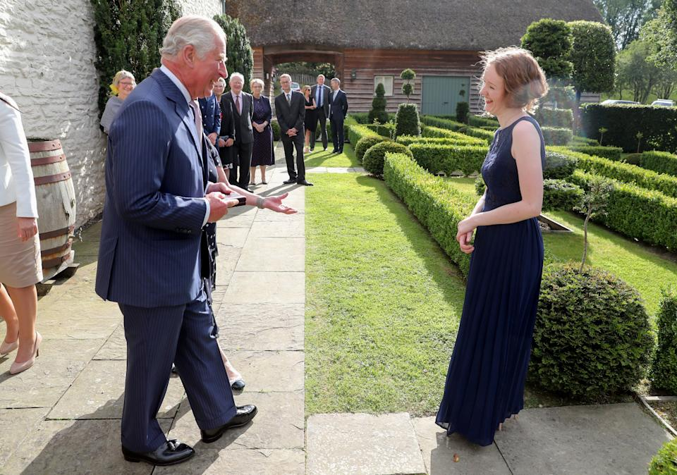 LLANDOVERY, WALES - JULY 02: Prince Charles, Prince of Wales presents Alis Huws, new Official Harpist to HRH The Prince of Wales, with the Royal Harpist's brooch, during a musical evening hosted at The Prince and The Duchess' official Welsh residence; Llwynywermod on July 02, 2019 in Llandovery, Wales. (Photo by Chris Jackson/Getty Images)