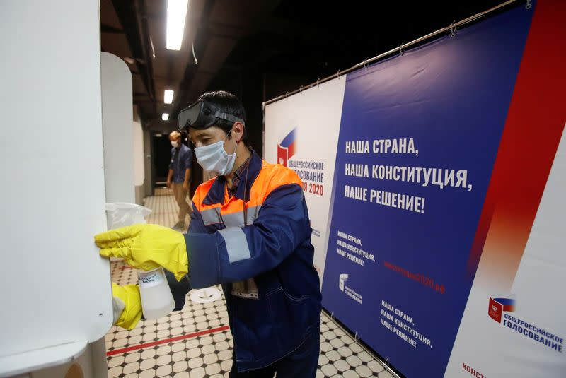 A specialist disinfects a polling station during a nationwide vote on constitutional reforms in Moscow