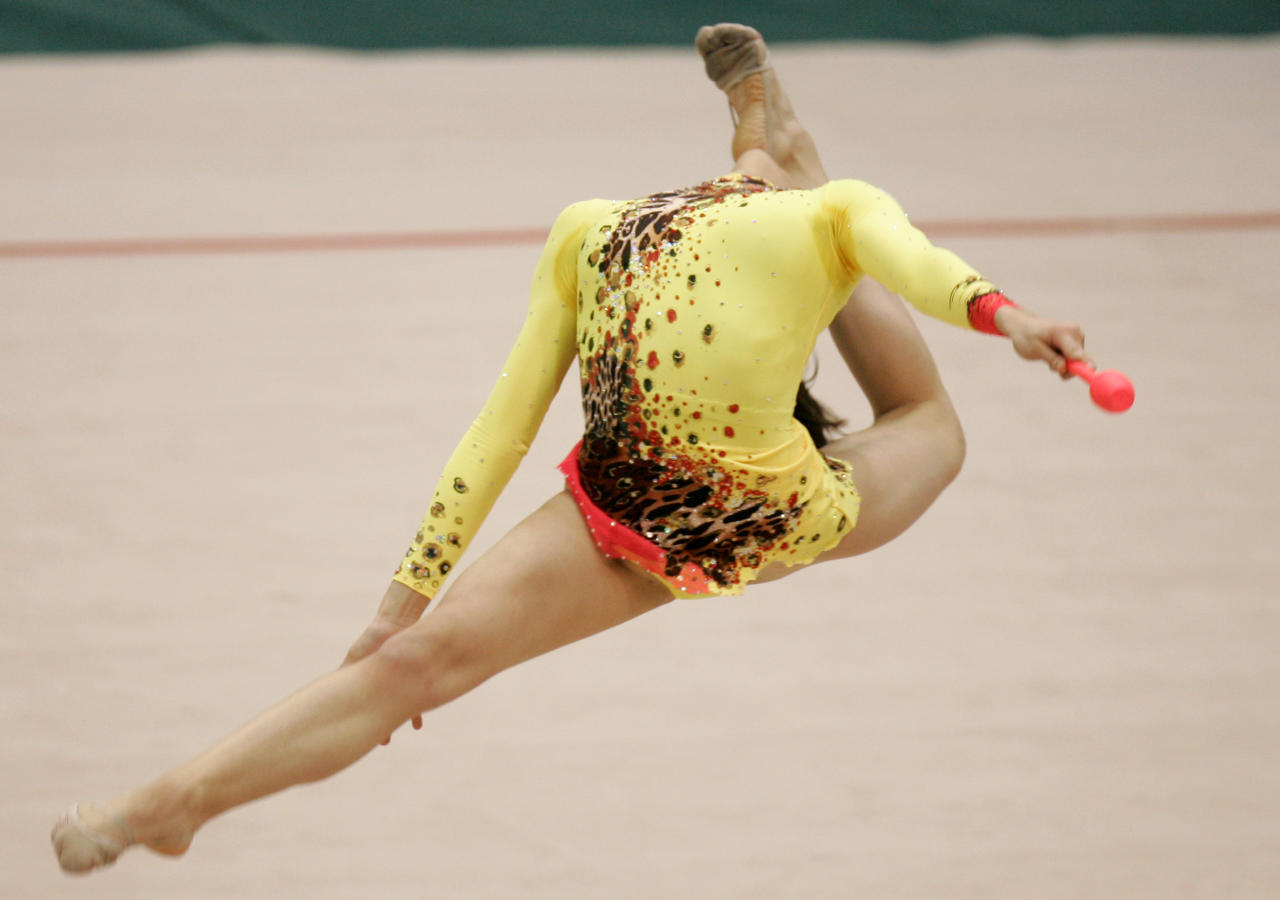 Nuria Artiguez of Spain performs with a clubs during the second day of rhythmic gymnastics World Cup 2008 tournament, in Ukraine's capital Kiev, on Saturday, March 22, 2008.  (AP Photo / Efrem Lukatsky)