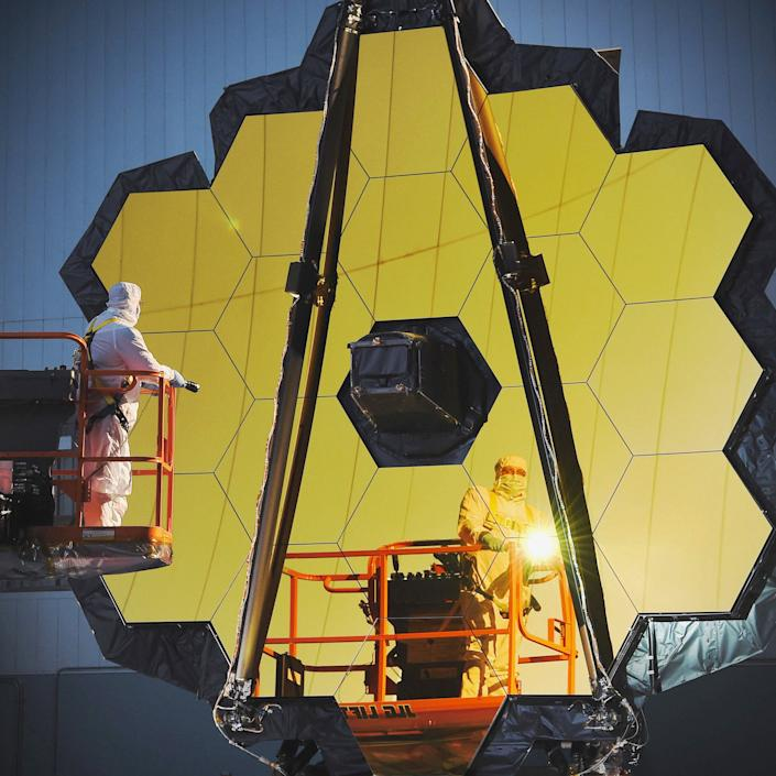 Engineers and technicians working on the James Webb Space Telescope.