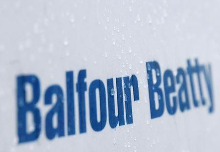 FILE PHOTO: Raindrops are seen on a sign at a Balfour Beatty construction site in central London September 29, 2014. REUTERS/Stefan Wermuth
