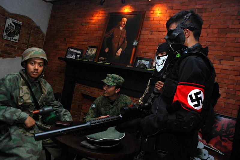 A portrait of Adolf Hitler hangs in the SoldatenKaffee (The Soldiers' Cafe) on Java Island, where Indonesian customers would come dressed in WWII military uniforms (AFP Photo/TIMUR MATAHARI)
