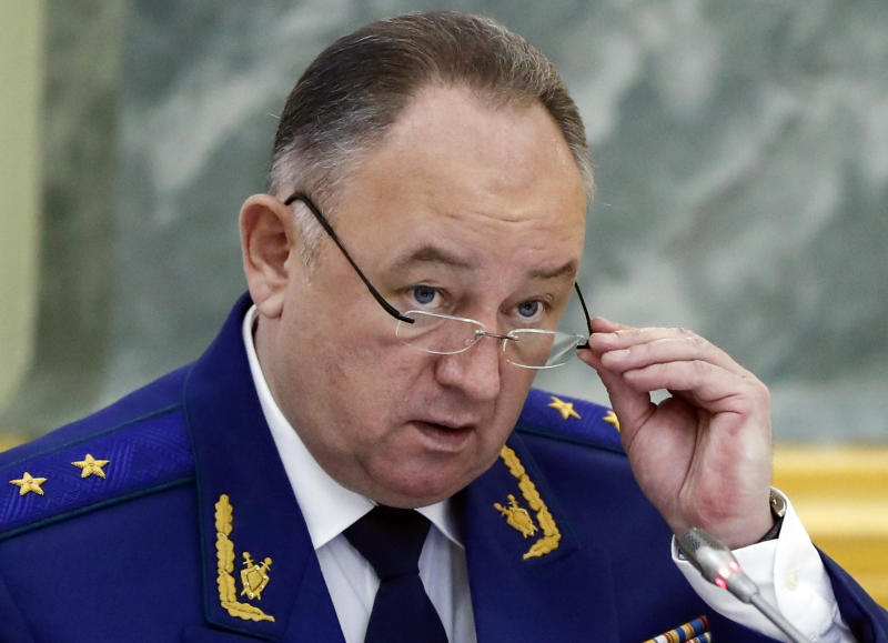 """An aide to the Russian Prosecutor General Nikolai Atmoniev speaks during a news conference in Moscow, Russia, Monday, Nov. 19, 2018. Russian prosecutors on Monday announced new charges against Bill Browder, accusing him of forming a criminal group to embezzle funds in Russia. They also said they suspect Magnitsky's death in prison was a poisoning and said they have a """"theory"""" Browder is behind the poisoning. (AP Photo/Pavel Golovkin)"""