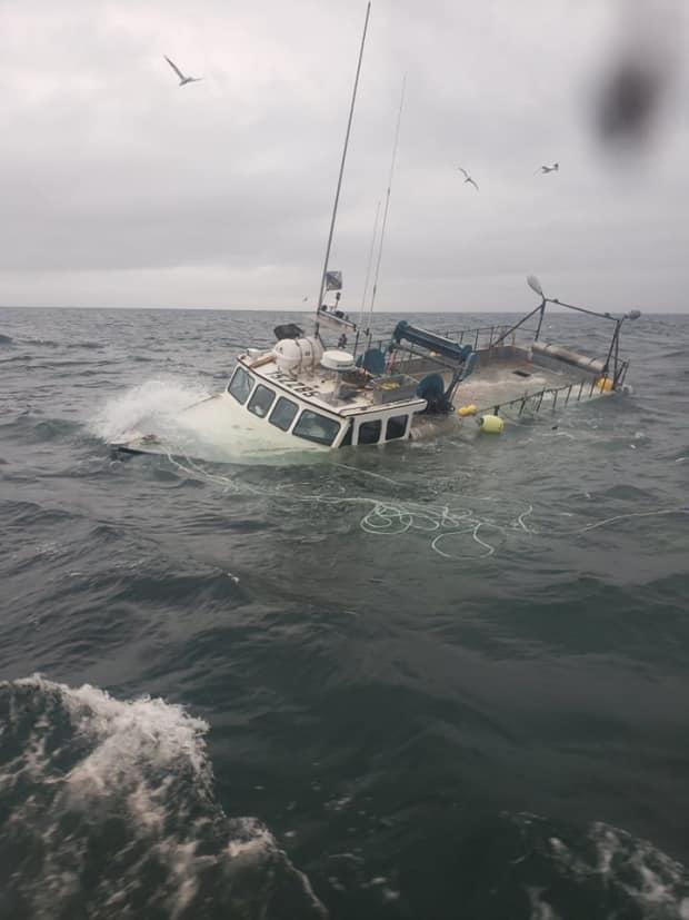 The captain decided to abandon ship after the fishing boat took on too much water. (Submitted by Steven Hughes - image credit)