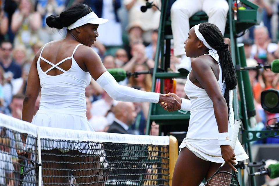 US player Cori Gauff is congratulated by US player Venus Williams after winning their women's singles first round match on the first day of the 2019 Wimbledon Championships at The All England Lawn Tennis Club in Wimbledon, southwest London, on July 1, 2019. (Photo by Ben STANSALL / AFP) / RESTRICTED TO EDITORIAL USE        (Photo credit should read BEN STANSALL/AFP via Getty Images)