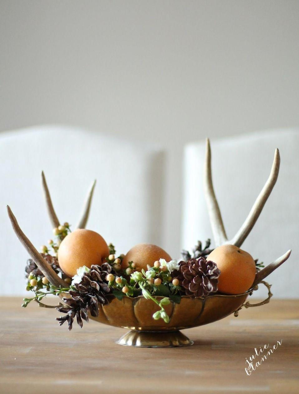 "<p>Most of the components in this centerpiece can be found in your backyard, making it quick to assemble. Pick up faux antlers at the craft store for a final flourish.</p><p><em><a href=""http://julieblanner.com/5-minute-thanksgiving-centerpiece/"" rel=""nofollow noopener"" target=""_blank"" data-ylk=""slk:Get the tutorial at Julie Blanner »"" class=""link rapid-noclick-resp"">Get the tutorial at Julie Blanner »</a></em></p>"