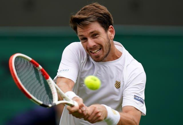 Cameron Norrie hits a backhand against Lucas Pouille