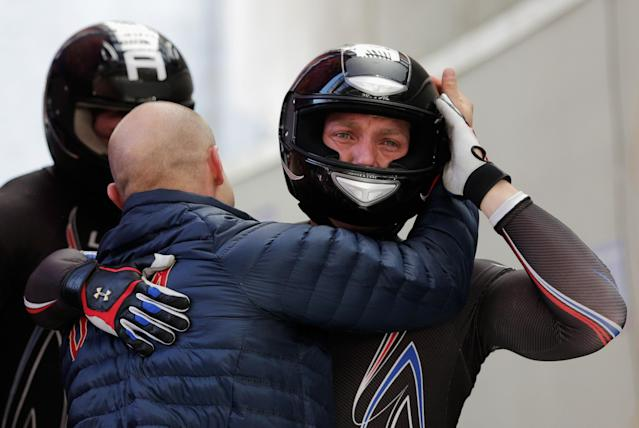 SOCHI, RUSSIA - FEBRUARY 23: Pilot Steven Holcomb, Curtis Tomasevicz, Steven Langton and Christopher Fogt of the United States team 1 react after their final run during the Men's Four-Man Bobsleigh on Day 16 of the Sochi 2014 Winter Olympics at Sliding Center Sanki on February 23, 2014 in Sochi, Russia. (Photo by Adam Pretty/Getty Images)