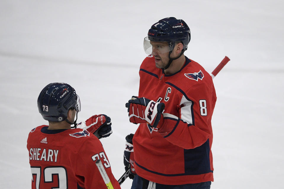 Washington Capitals left wing Alex Ovechkin (8) celebrates his goal with left wing Conor Sheary (73) during the third period of an NHL hockey game against the Philadelphia Flyers, Tuesday, April 13, 2021, in Washington. The Capitals won 6-1. (AP Photo/Nick Wass)