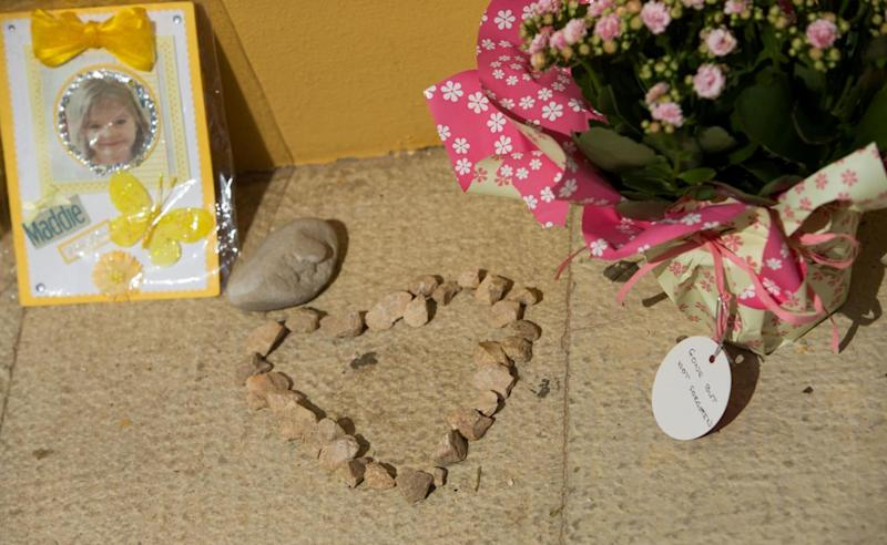 Outpouring of love: Tributes to Madeleine McCann outside the Church of Nossa Senhora da Luz in Praia Da Luz, Portugal (PA)
