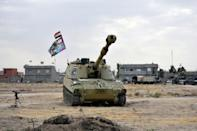An Iraqi army tank is seen near a former Kurdish military position on October 13, 2017 in the northern town of Taza Khurmatu in Iraq's oil-rich multi-ethnic province of Kirkuk