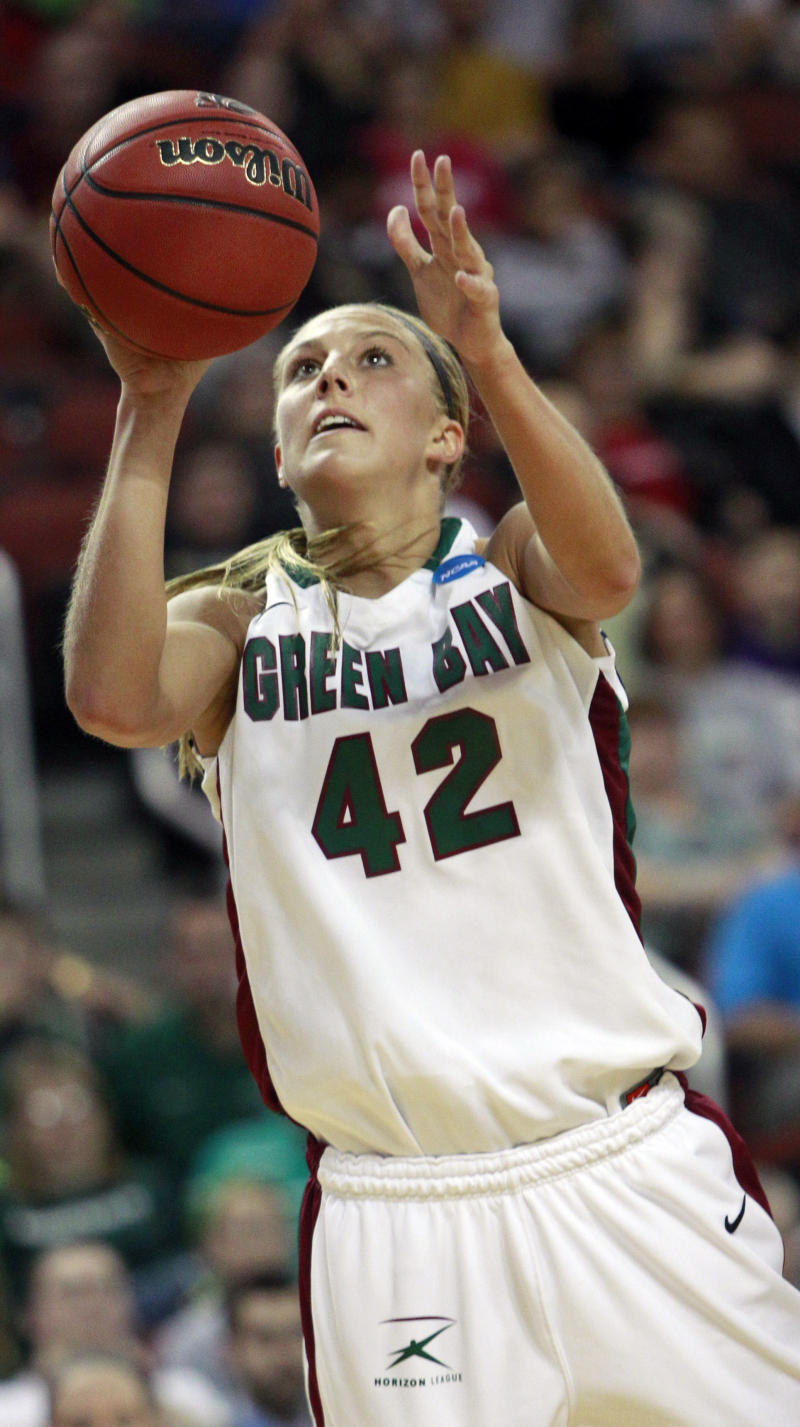 Wisconsin-Green Bay forward Kayla Tetschlag (42) shoots a basket during the second half of an NCAA women's college basketball tournament game against Arkansas-Little Rock Sunday, March 20, 2011, in Wichita, Kan. Wisconsin-Green Bay defeated Arkansas-Little Rock 59-55. (AP Photo/Orlin Wagner)
