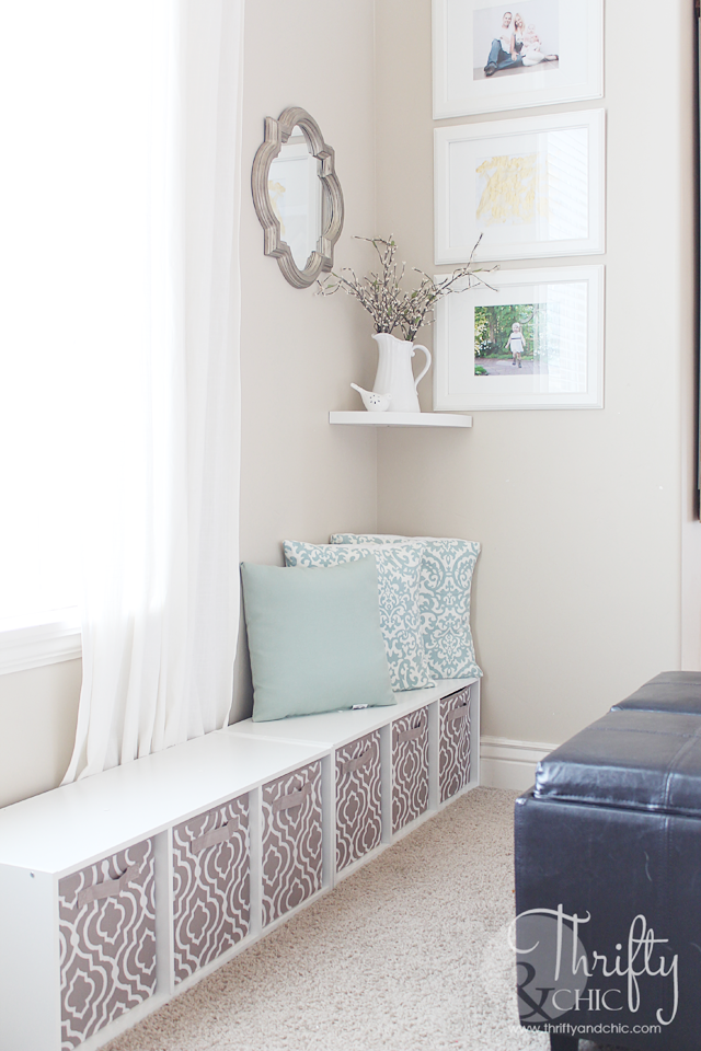 """<p>But a window seat is the perfect solution to functional storage: Toys fit inside the baskets and stay out of way when they're not being used — plus, it offers a seat for quiet reading time.</p><p><em><a href=""""http://www.thriftyandchic.com/2015/03/hidden-play-area-in-plain-sight.html"""" rel=""""nofollow noopener"""" target=""""_blank"""" data-ylk=""""slk:See more at Thrifty and Chic »"""" class=""""link rapid-noclick-resp"""">See more at Thrifty and Chic »</a></em></p><p><strong>What you'll need: </strong><span class=""""redactor-invisible-space"""">storage bench, $67, <a href=""""https://www.amazon.com/ClosetMaid-1569-Cubeicals-3-Cube-Storage/dp/B00BHWTS2Q/?tag=syn-yahoo-20&ascsubtag=%5Bartid%7C2139.g.36060899%5Bsrc%7Cyahoo-us"""" rel=""""nofollow noopener"""" target=""""_blank"""" data-ylk=""""slk:amazon.com"""" class=""""link rapid-noclick-resp"""">amazon.com</a></span><br></p>"""