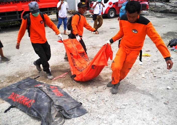 A total 2,065 bodies have been recovered since the twin disaster (AFP Photo/MUHAMMAD RIFKI)