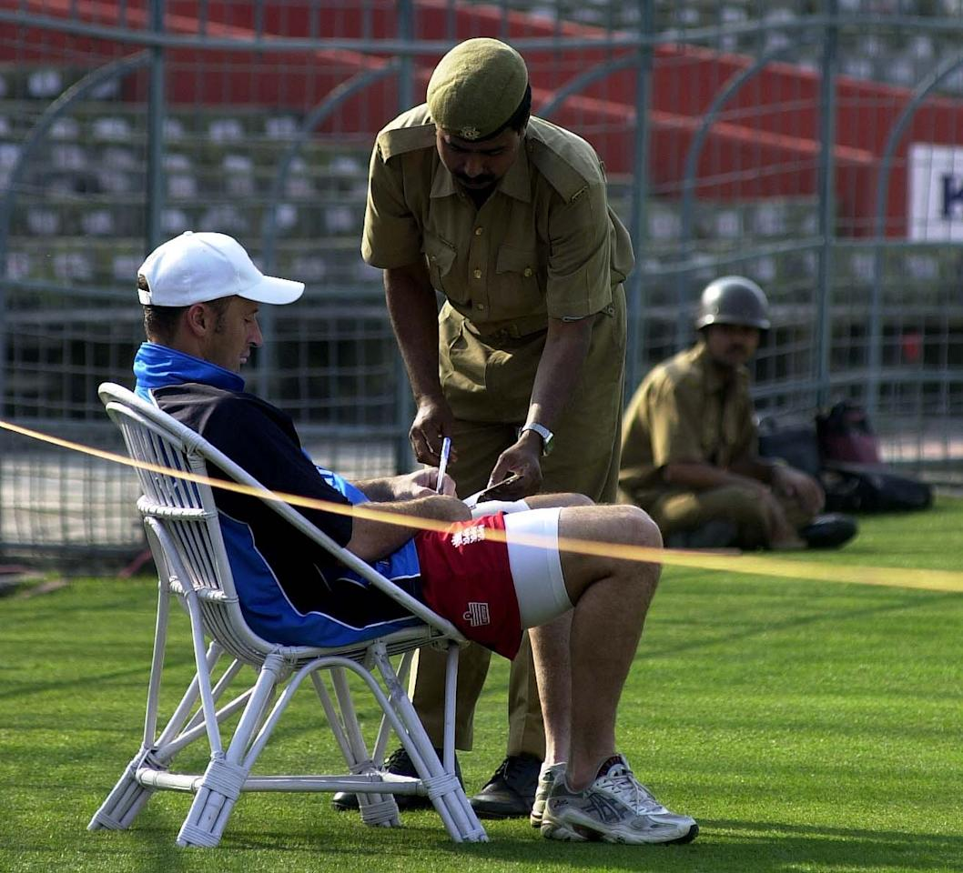 16 Jan 2002:  England captain Nasser Hussain signs some autographs for the army during the England nets session at Eden Gardens Cricket Stadium, Kolkata, India. DIGITAL IMAGE. Mandatory Credit: Tom Shaw/Getty Images