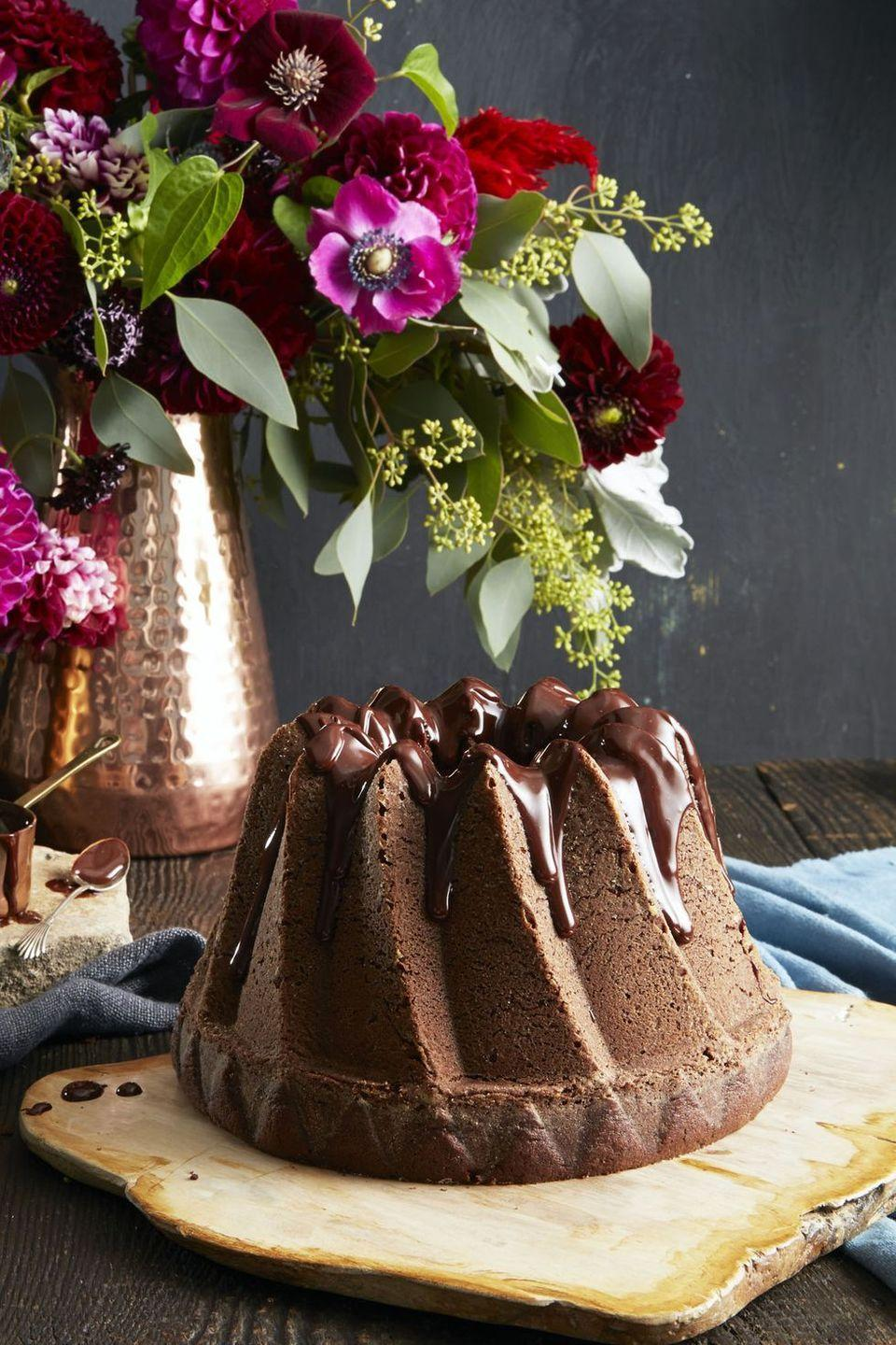 """<p>Strong-brewed coffee in the batter and the frosting really amps up the cocoa flavor — and it'll keep the adults awake for a long night of trick-or-treating.</p><p><em><a href=""""https://www.goodhousekeeping.com/food-recipes/dessert/a35180/double-chocolate-bundt/"""" rel=""""nofollow noopener"""" target=""""_blank"""" data-ylk=""""slk:Get the recipe for Double Chocolate Bundt »"""" class=""""link rapid-noclick-resp"""">Get the recipe for Double Chocolate Bundt »</a></em></p><p><strong>RELATED: </strong><a href=""""https://www.goodhousekeeping.com/food-recipes/cooking/g32223075/how-to-make-coffee-at-home/"""" rel=""""nofollow noopener"""" target=""""_blank"""" data-ylk=""""slk:Here's How to Make Coffee at Home Using 7 Different Brewing Methods"""" class=""""link rapid-noclick-resp"""">Here's How to Make Coffee at Home Using 7 Different Brewing Methods</a><br></p>"""