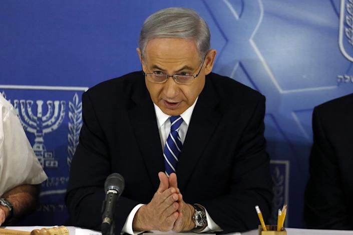 Israeli Prime Minister Benjamin Netanyahu speaks as he opens the weekly cabinet meeting at the Defense Ministry in the costal city of Tel Aviv on August 24, 2014 (AFP Photo/Gali Tibbon)