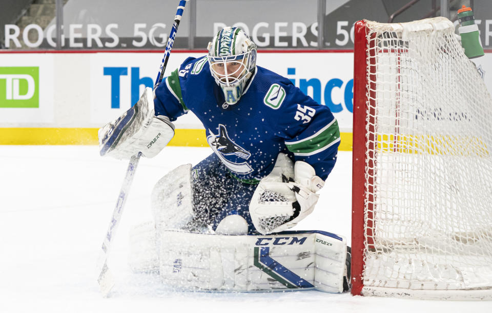 VANCOUVER, BC - MARCH 22: Goalie Thatcher Demko #35 of the Vancouver Canucks readies to make a save during NHL action against the Winnipeg Jets at Rogers Arena on March 22, 2021 in Vancouver, Canada. (Photo by Rich Lam/Getty Images)