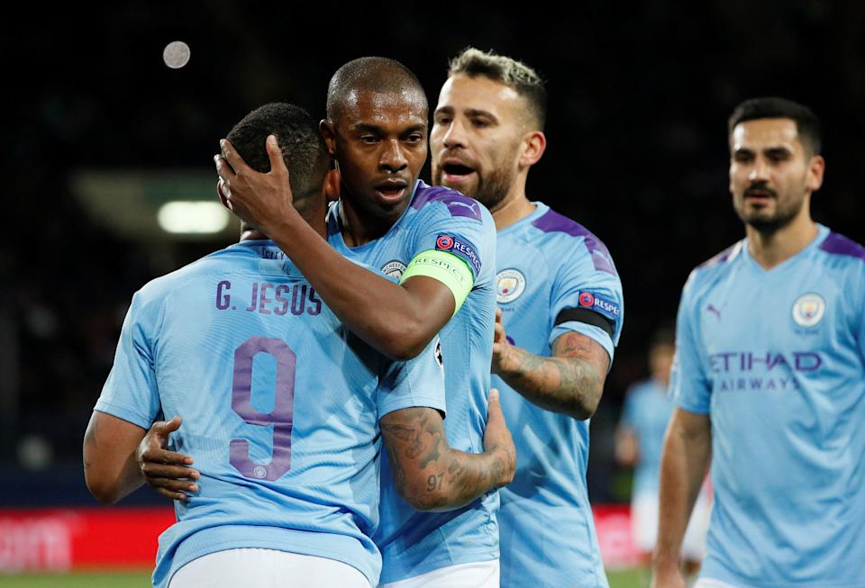 Soccer Football - Champions League - Group C - Shakhtar Donetsk v Manchester City - Metalist Stadium, Kharkiv, Ukraine - September 18, 2019  Manchester City's Gabriel Jesus celebrates scoring their third goal with Fernandinho, Nicolas Otamendi and Ilkay Gundogan   REUTERS/Gleb Garanich