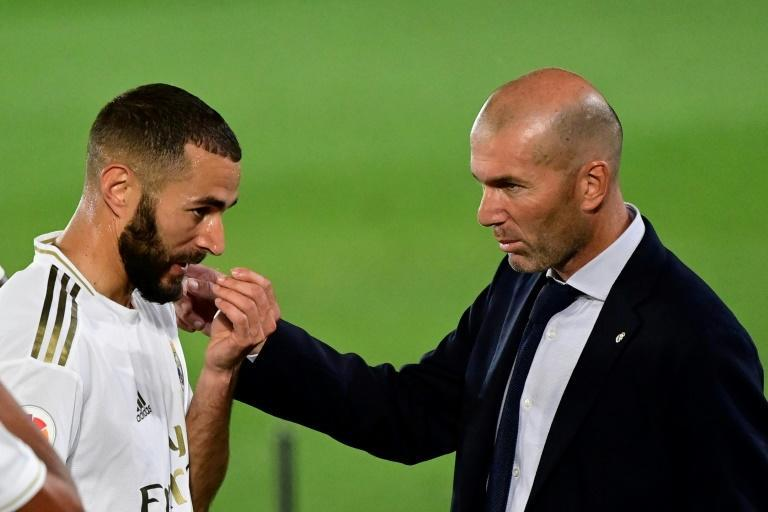 Moment of magic: Karim Benzema seen here with Real Madrid coach Zinedine Zidane (AFP Photo/JAVIER SORIANO)