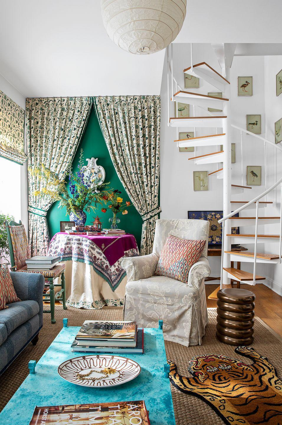 """<p>""""I love the juxtaposition between the traditional space and the modern staircase,"""" says Eliza Crater of <a href=""""https://sisterparishdesign.com/"""" rel=""""nofollow noopener"""" target=""""_blank"""" data-ylk=""""slk:Sister Parish Design"""" class=""""link rapid-noclick-resp"""">Sister Parish Design</a>. The rich kelly green accent wall and decorative floral curtains help bring some fullness and warmth to otherwise all-white surfaces. </p>"""