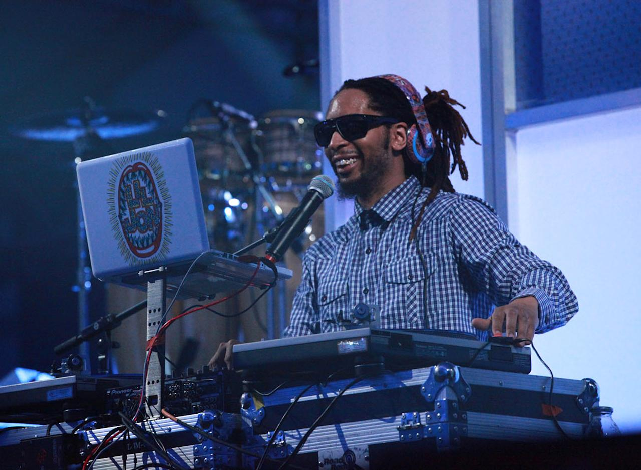 Lil Jon spins a DJ set before Pitbull and 50 Cent perform at the Bud Light Hotel concert .