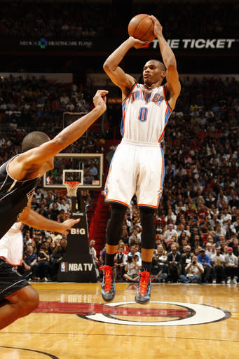 MIAMI, FL - APRIL 4: Russell Westbrook #0 of the Oklahoma City Thunder shoots against the Miami Heat on April 4, 2012 at American Airlines Arena in Miami, Florida. (Photo by Issac Baldizon/NBAE via Getty Images)
