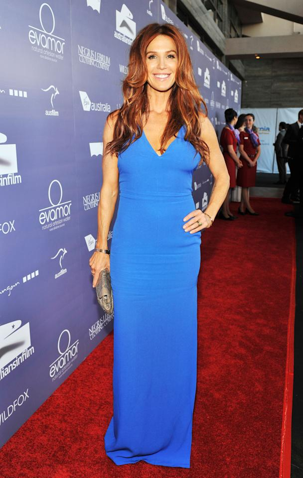 CENTURY CITY, CA - JUNE 27:  Actress Poppy Montgomery arrives at Australians In Film Awards & Benefit Dinner at InterContinental Hotel on June 27, 2012 in Century City, California.  (Photo by Toby Canham/Getty Images for AIF)