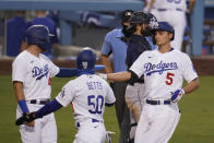 Los Angeles Dodgers' Corey Seager (5) celebrates his three-run home run with Mookie Betts (50) and Matt Beaty during the second inning of a baseball game against the Seattle Mariners Monday, Aug. 17, 2020, in Los Angeles. (AP Photo/Marcio Jose Sanchez)